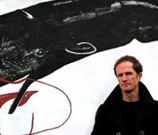 Photograph of Philip Hoare in front of mural of a whale