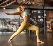 photo of yoga instructor in a yoga pose in the Museum